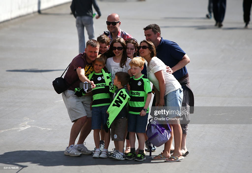 A family of Forest Green Rovers fans pose for a selfie ahead of the Vanarama Football Conference League Play Off Final between Forest Green Rovers and Grimsby Town at Wembley Stadium on May 15, 2016 in London, England.