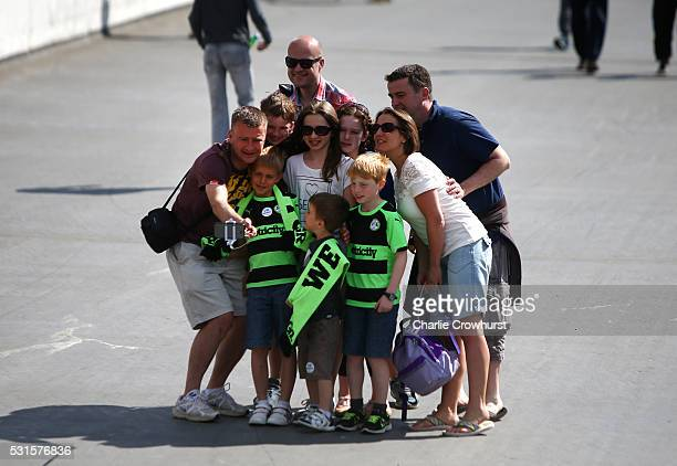 A family of Forest Green Rovers fans pose for a selfie ahead of the Vanarama Football Conference League Play Off Final between Forest Green Rovers...