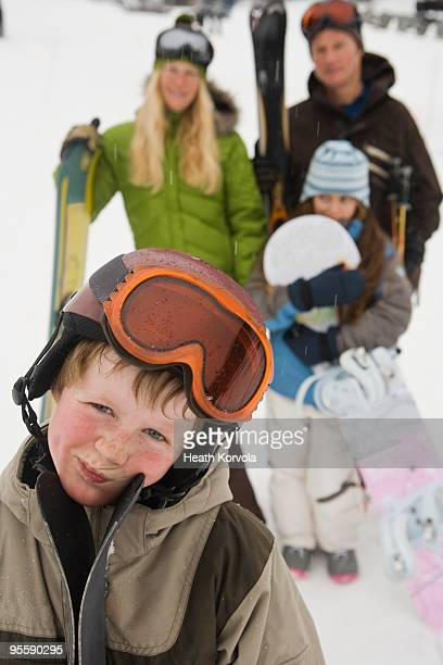 family of four at ski resort in winter. - rosy cheeks stock pictures, royalty-free photos & images