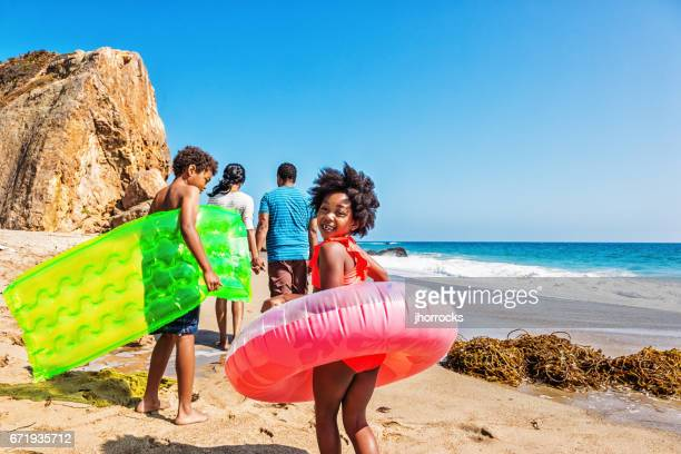 family of four at the beach - black people having fun stock photos and pictures