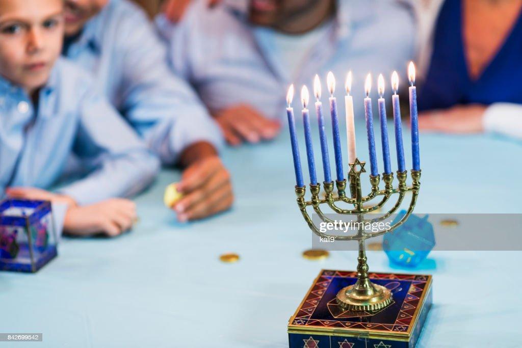 Family of four celebrating hanukkah : Stock Photo