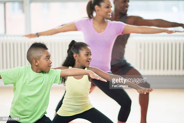 Family of Four Doing Yoga at the Gym