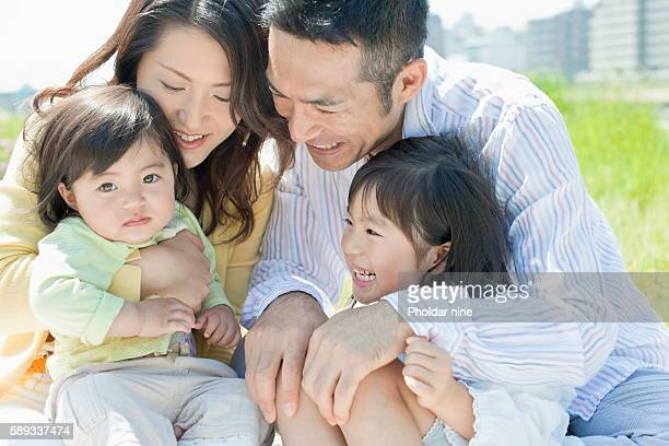 Family of Four Embracing Each Other