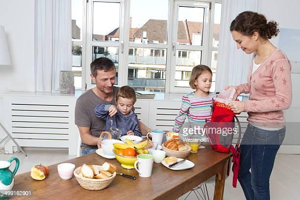 Family of four having healthy breakfast