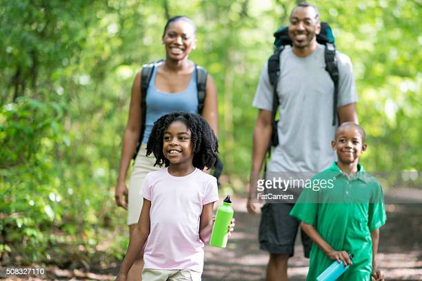 Family of Four Hiking Together