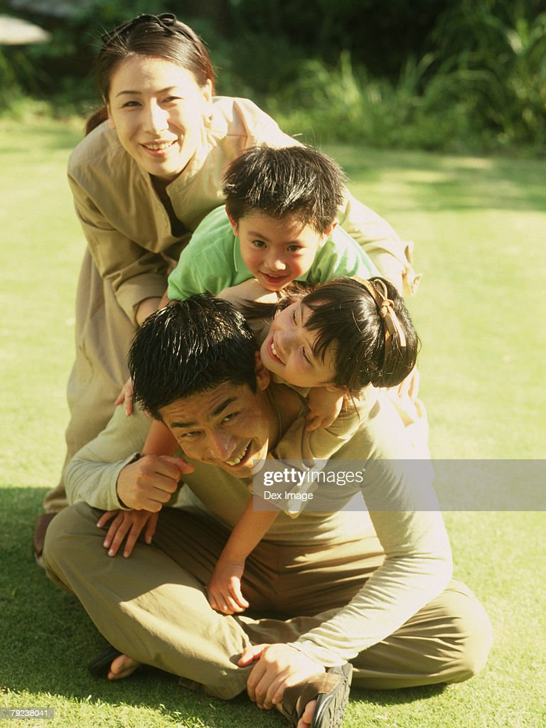 Family of four in a park : Stock Photo