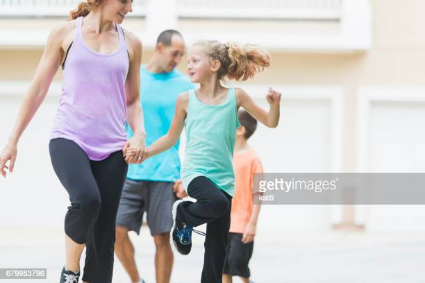 family of four, mother and daughter skipping - skipping along stock pictures, royalty-free photos & images