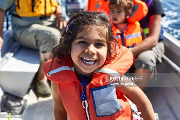 family of four on boat ride - life jacket stock pictures, royalty-free photos & images
