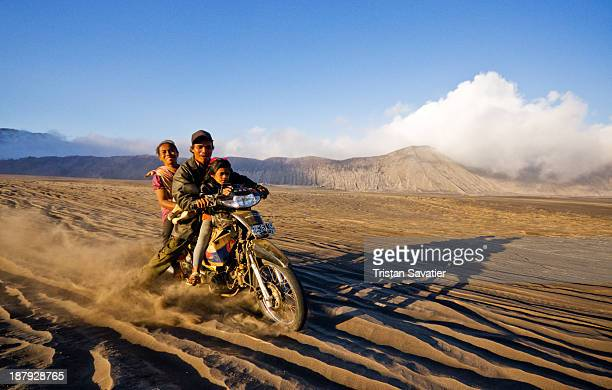 CONTENT] Family of four on their small motorcycle got stuck in the deep sand of the Lautan Pasir desert in the Tengger Caldera on Java Island This...