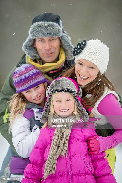 Family of Four Outside in the Snow