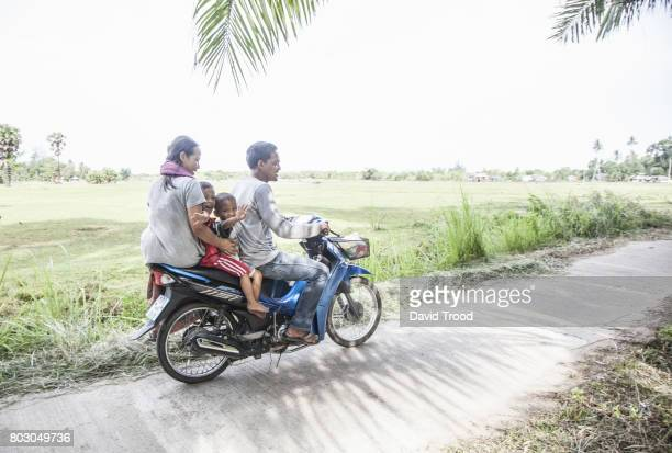 Family of four people on scooter