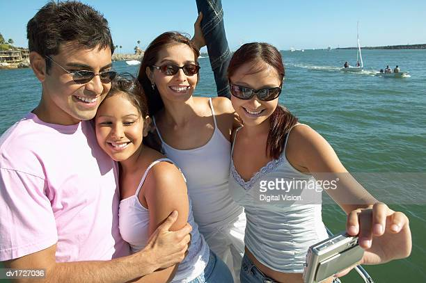 Family of Four Photographing Themselves on a Boat