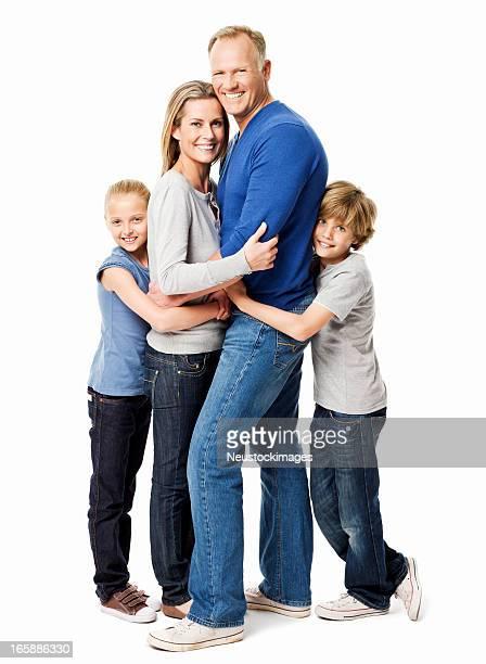 Vierköpfige Familie posieren liebevoll-isoliert