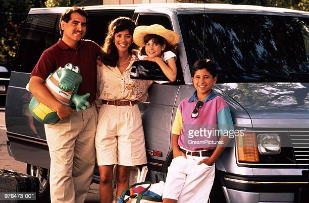 family of four standing by vehicle with luggage - 1990~1999年 ストックフォトと画像