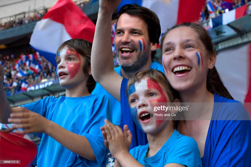 Family of French football fans at Stadium : Stock Photo