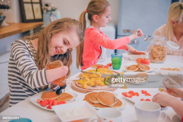 family of girls having a big breakfast - amputee girl stock pictures, royalty-free photos & images