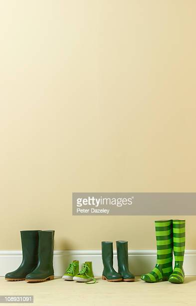 family of green wellington boots - oversized stock pictures, royalty-free photos & images