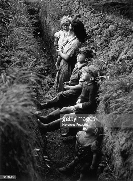 A family of gypsies who are hoppicking in Hunton Kent in a trench which is used as an air raid shelter