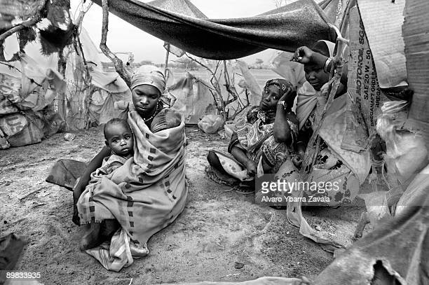 A family of Internally Displaced People They have built a small tent to survive in the middle of the desert