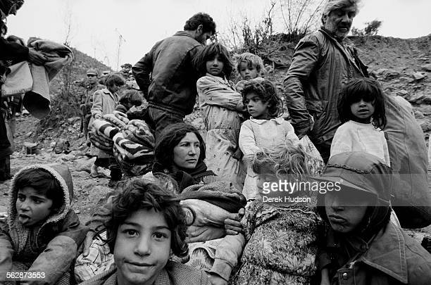 A family of Iraqi Kurds await food aid on a hillside in the barren no man's land near the the Turkish town of Isikveren The Iraqi Kurdish community...