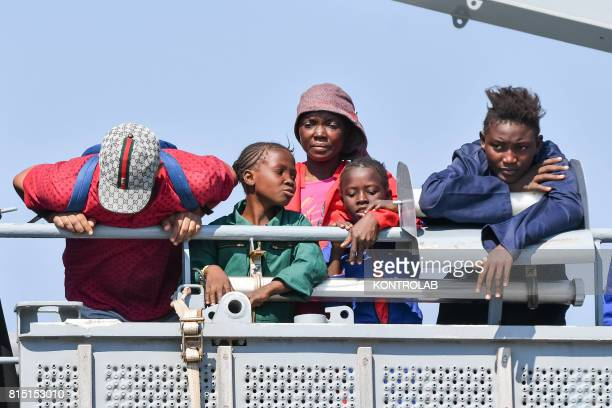 Family of migrants during the landing stages of migrants from the German military ship Rhein. Refugees landed are 990, among them, 203 unaccompanied...