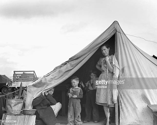 A family of migratory workers that came to Merrill Klamath County Oregon for the potato harvest and are living in a Farm Security Administration...