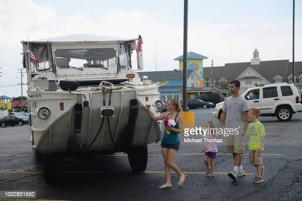 A family of mourners stop to place a flower on a World War II DUKW boat used by Ride The Ducks tours on July 20 2018 in Branson Missouri Hundreds of...