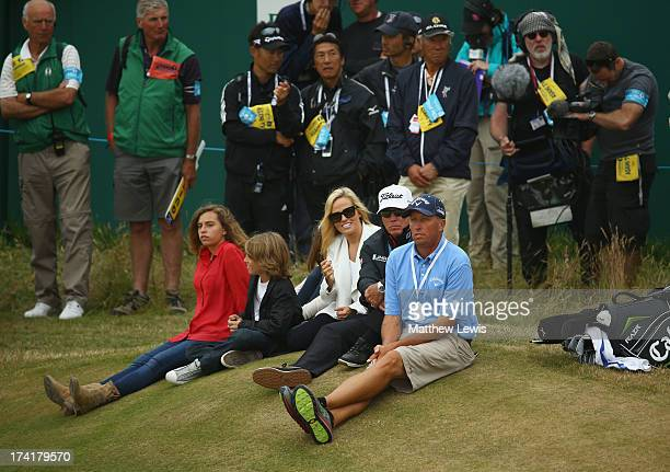 Family of Phil Mickelson children Sophia and Evan wife Amy coach Butch Harmon and caddie Jim Mackay sit by the 18th green during the 142nd Open...