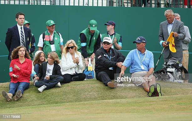 Family of Phil Mickelson children Sophia Evan and Amanda wife Amy coach Butch Harmon caddie Jim Mackay and former coach Steve Loy sit by the 18th...