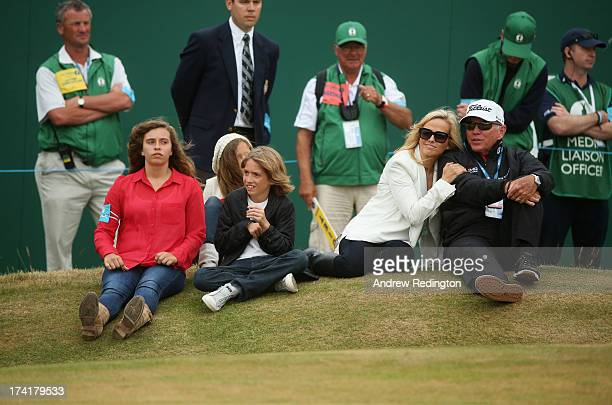 Family of Phil Mickelson daughters Sophia and Amanda son Evan wife Amy and coach Butch Harmon sit by the 18th green during the 142nd Open...