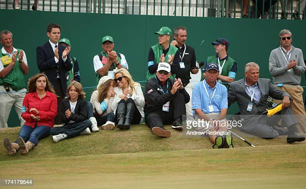 Family of Phil Mickelsonchildren Sophia Evan and Amanda wife Amy coach Butch Harmon caddie sit by the 18th green during the 142nd Open Championship...