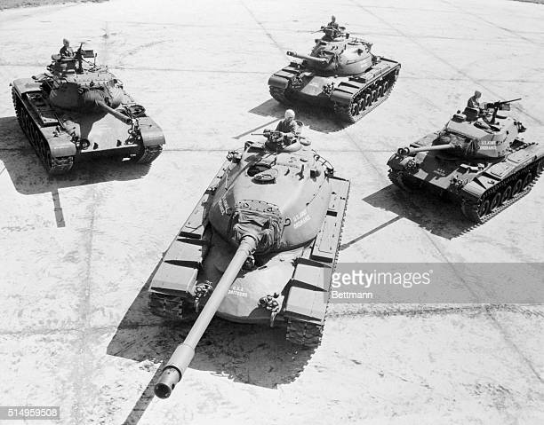 A 'family' of post World War II tanks is grouped at Aberdeen Proving Ground with the formidable heavy gun tank T43 looking very much like the 'daddy'...