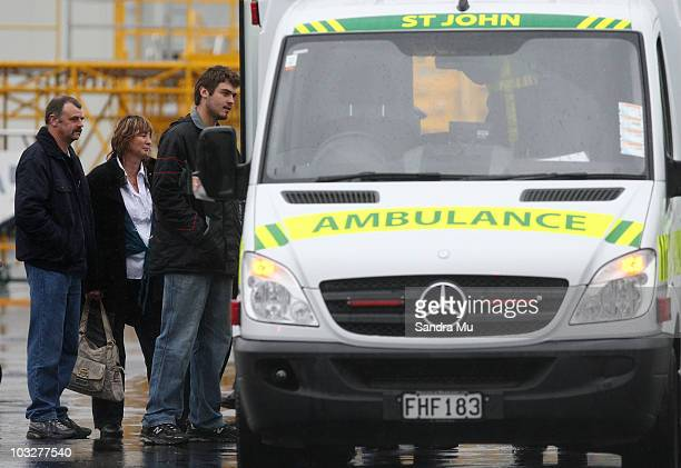 Family of Private Allister Baker watch as he is placed in the back of an ambulance at Whenuapai Air Force Base on August 7 2010 in Auckland New...