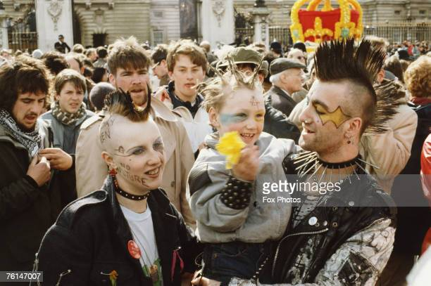 A family of punks among the crowds celebrating the 60th birthday of Queen Elizabeth II outside Buckingham Palace London 21st April 1986