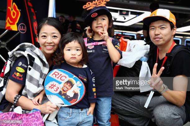 A family of Red Bull Racing fans poses for a photo in the Pitlane during previews ahead of the Formula One Grand Prix of Japan at Suzuka Circuit on...