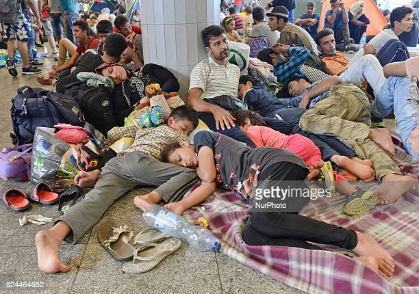 A family of refugees from Syria at Budapest Keleti railway station as for the second day migrants camp out at the train station facilities Tuesday 2...
