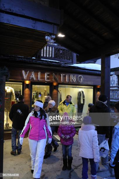 A family of russian tourists go to shopping at the Valentino luxury and fashion shop Courchevel 1850 ski resort Trois Vallees skiing area Tarentaise...