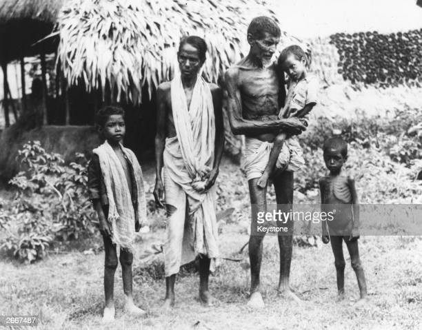 Family of semi-starved Indians who have arrived in Calcutta in search of food.
