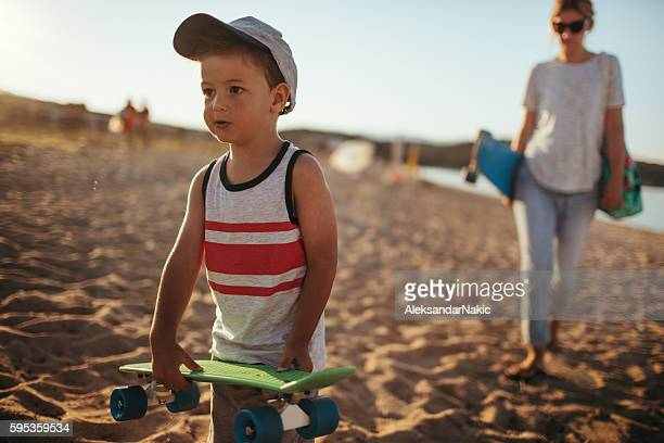 family of skateboarders - mothers day beach stock pictures, royalty-free photos & images