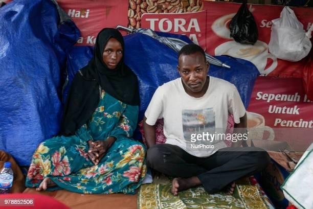 A family of Somalian refugee settling on the roadside in front of the overcapacity immigration detention house in Jakarta Indonesia on June 19 2018...