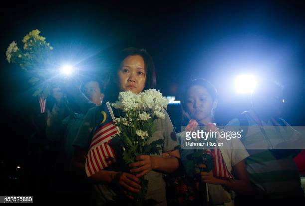 Family of the crew members of MH17 pay their respect during a vigil on July 22 2014 in Kuala Lumpur Malaysia Malaysia Airlines flight MH17 was...