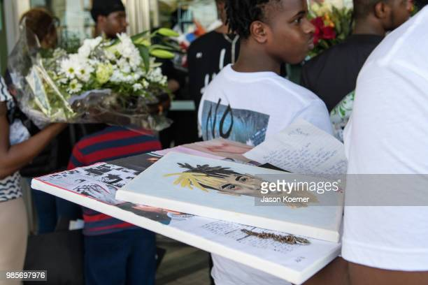 Family of the rapper collect items from a makeshift memorial outisde the XXXTentacion Funeral Fan Memorial at BBT Center on June 27 2018 in Sunrise...