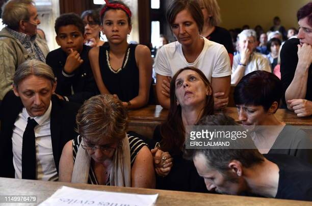 Family of the victim pictured at a session to announce the verdict at the assizes trial of four men and a woman accused for the murder on Valentin...