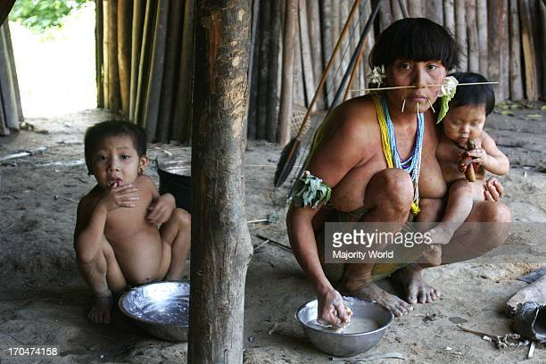 A family of the Yanomami tribe Considered the Native Americans of South America the forestdwelling tribe live in the Amazon rainforest on both sides...