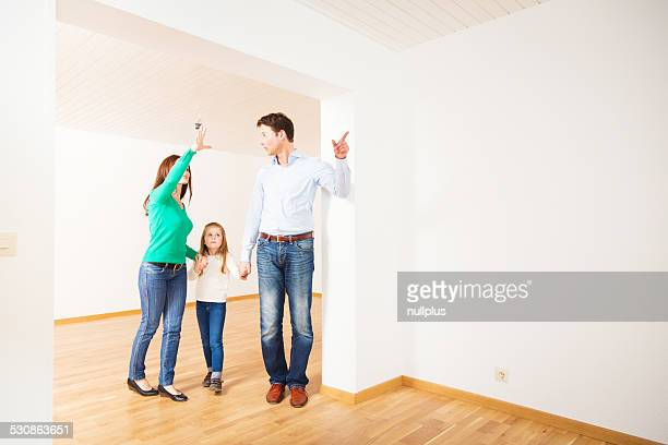 family of three are happy with their new apartment