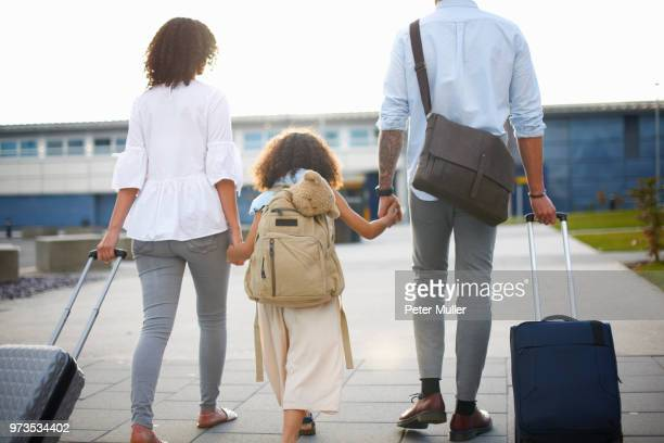 Family of three going on vacation