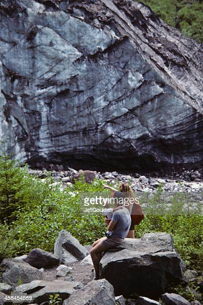 Family of Hikers Rests Near the Carbon Glacier's Snout