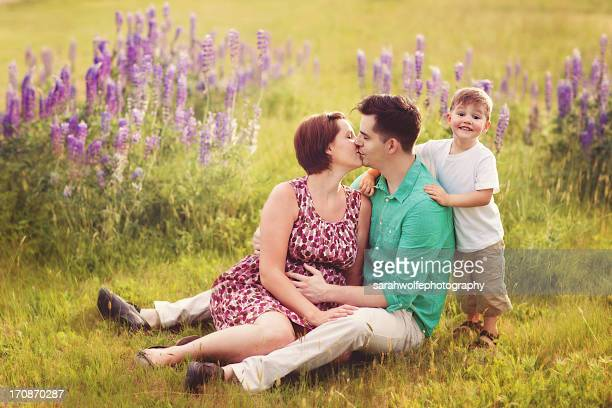 family of three in a flower field