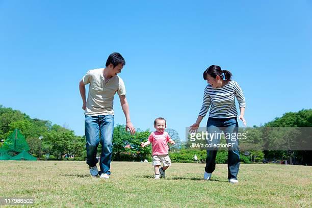 Family of Three in Park