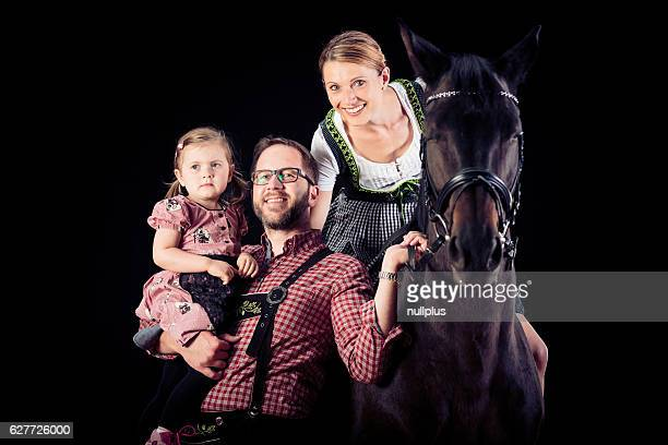 Family Of Three With Their Horse